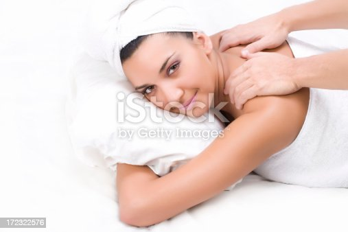 525211834istockphoto Back massage of woman with towel isolated on white 172322576