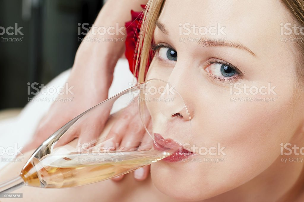 Back massage with sparkling wine royalty-free stock photo