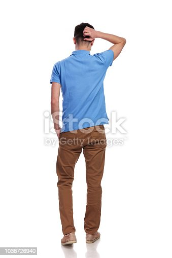 istock back of a confused man scratching his head 1038726940