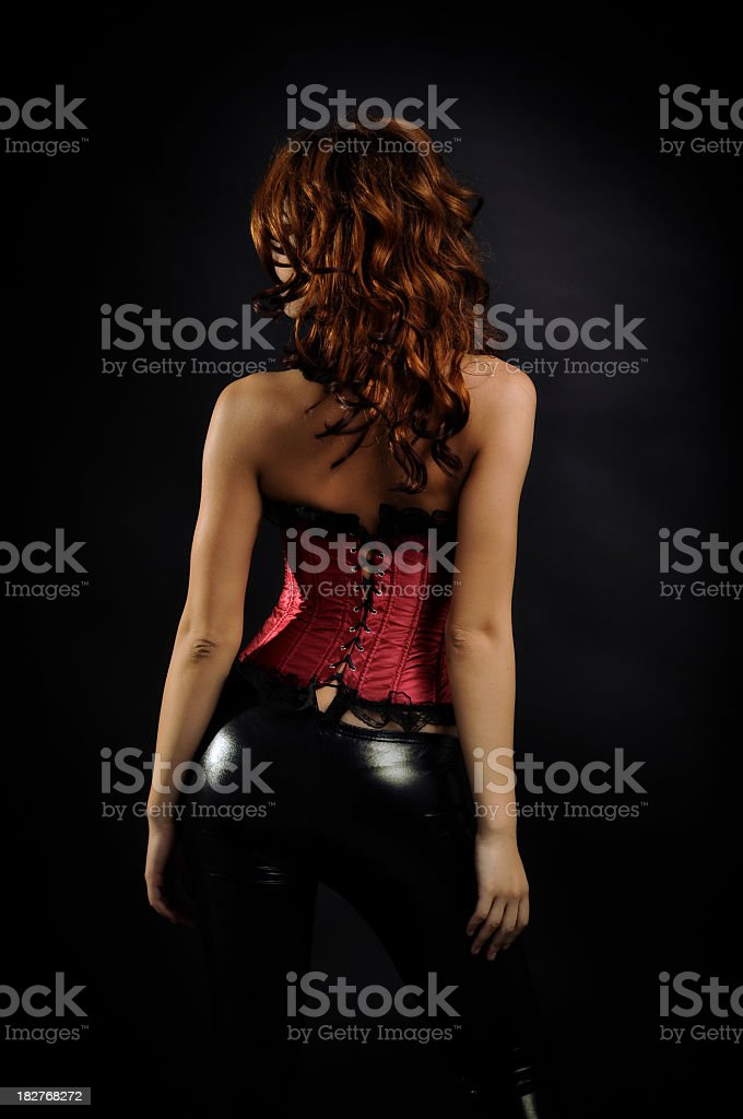 back of a nice woman dressed with red corset stock photo
