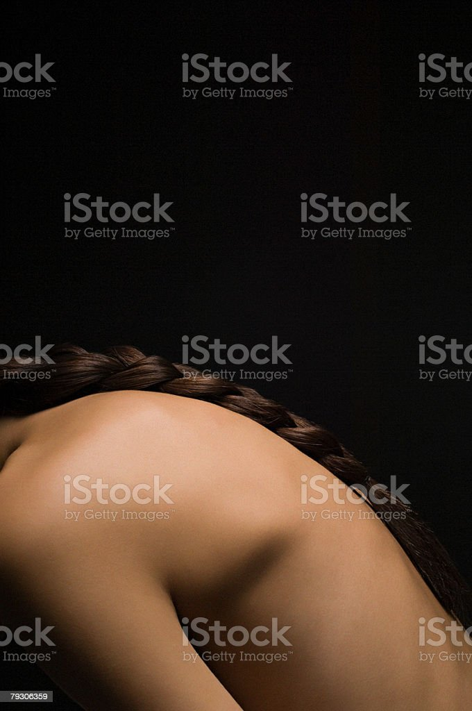 Back of a woman with plaited hair royalty-free 스톡 사진