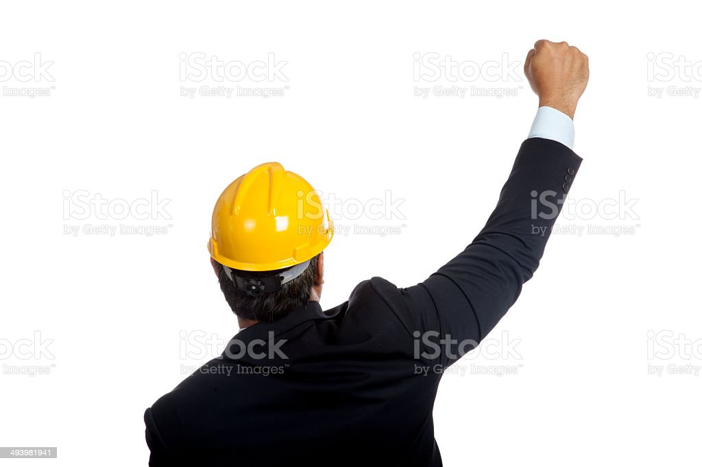 Back of Asian engineer man rise fist up for success stock photo