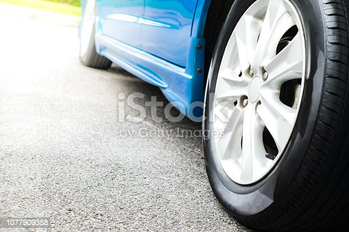 837409978 istock photo Back of blue car wheels in sunset 1077909358
