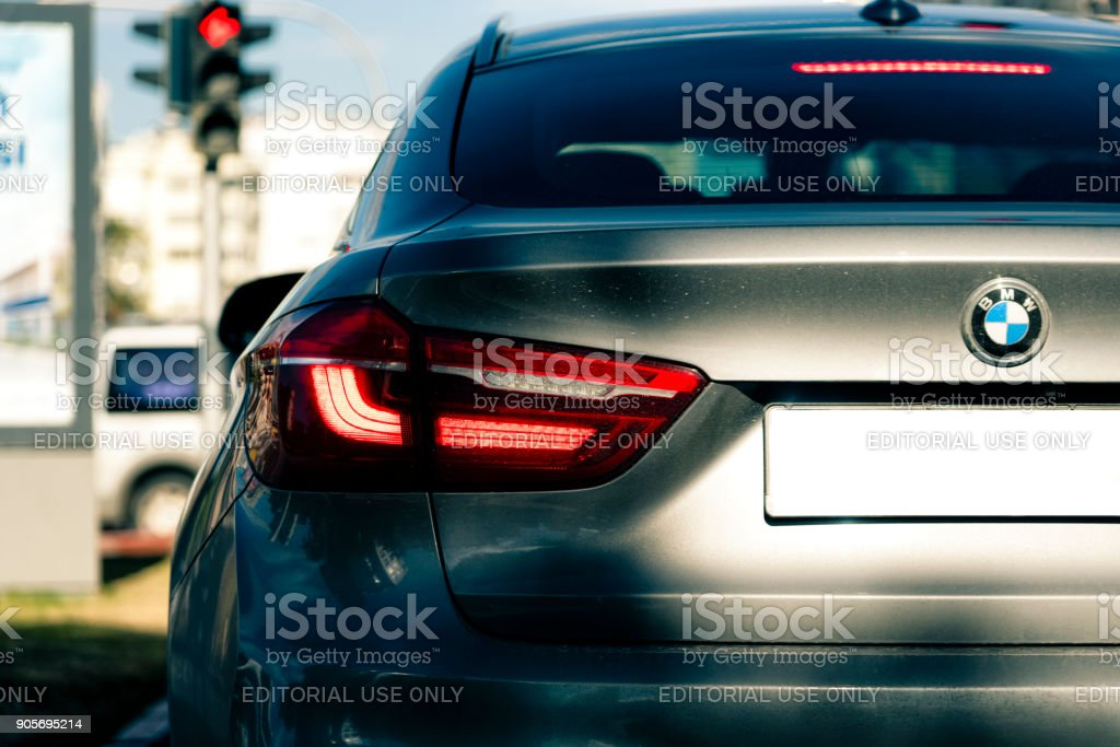 Back of BMW X6 in traffic Back of grey BMW X6 car standing in traffic light BMW Stock Photo