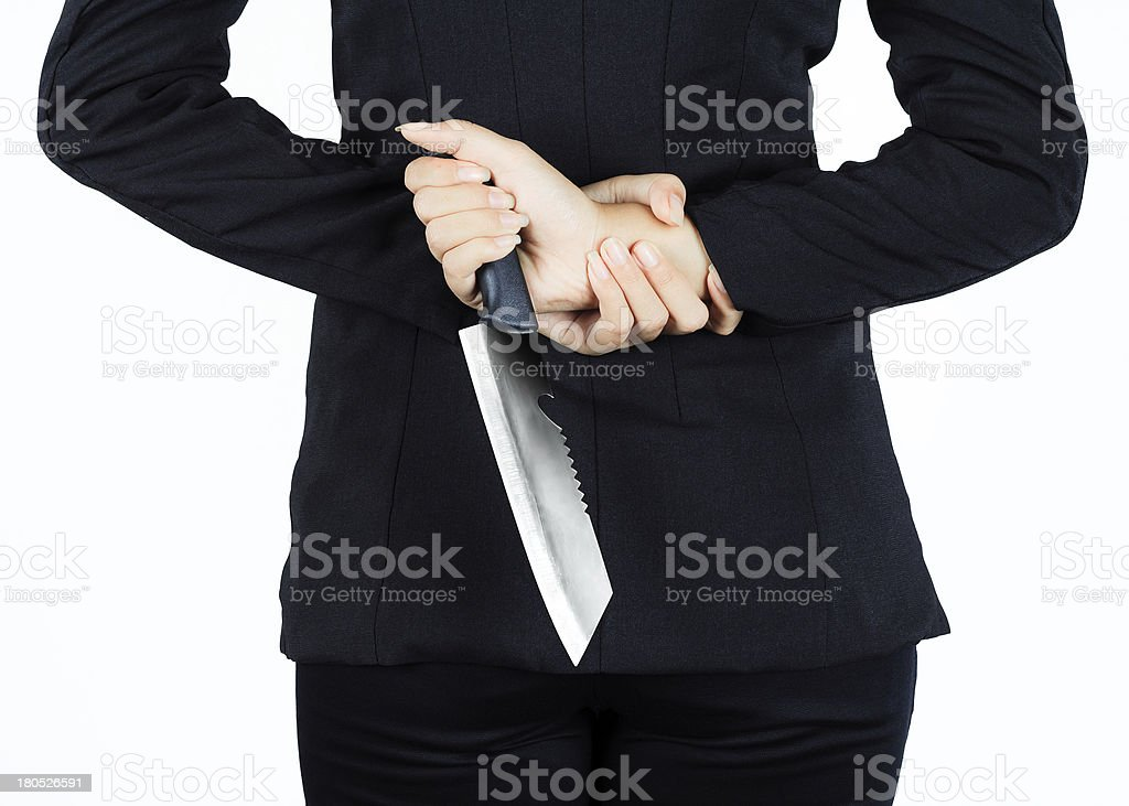 Back of business woman with aknife royalty-free stock photo