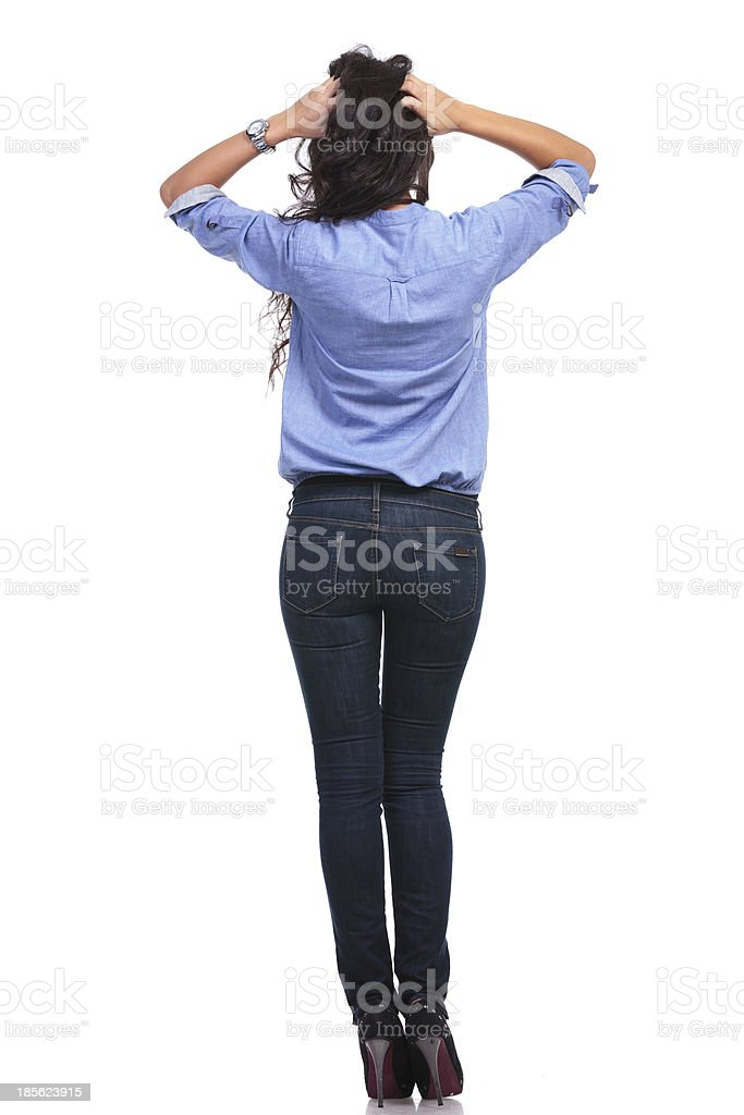 back of casual woman with hands in hair stock photo
