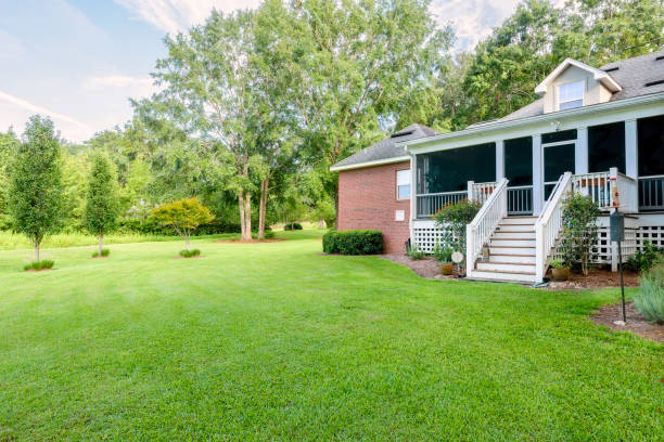 Back of Colonial Brick House with Landscaped Yard