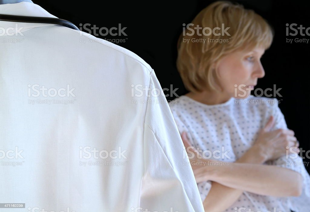 Back of doctor in lab coat and female patient royalty-free stock photo