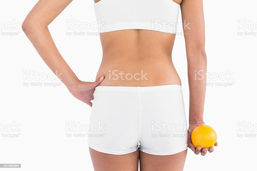 Back of female slender body in shorts stock photo