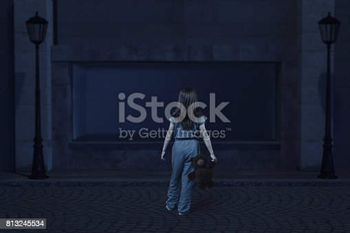 istock back of girl with teddy bear in the hand who get lost at the old city 813245534
