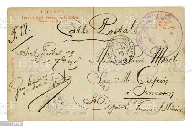 Back of historical French postcard. Beautiful calligraphic handwriting, the text of the letter is written in black ink with curls. Postmark cancellation,  world war one 1915. France