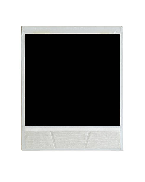 Back of instant film isolated on white stock photo