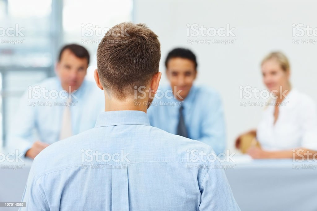 Back of man's head while he's being interviewed royalty-free stock photo