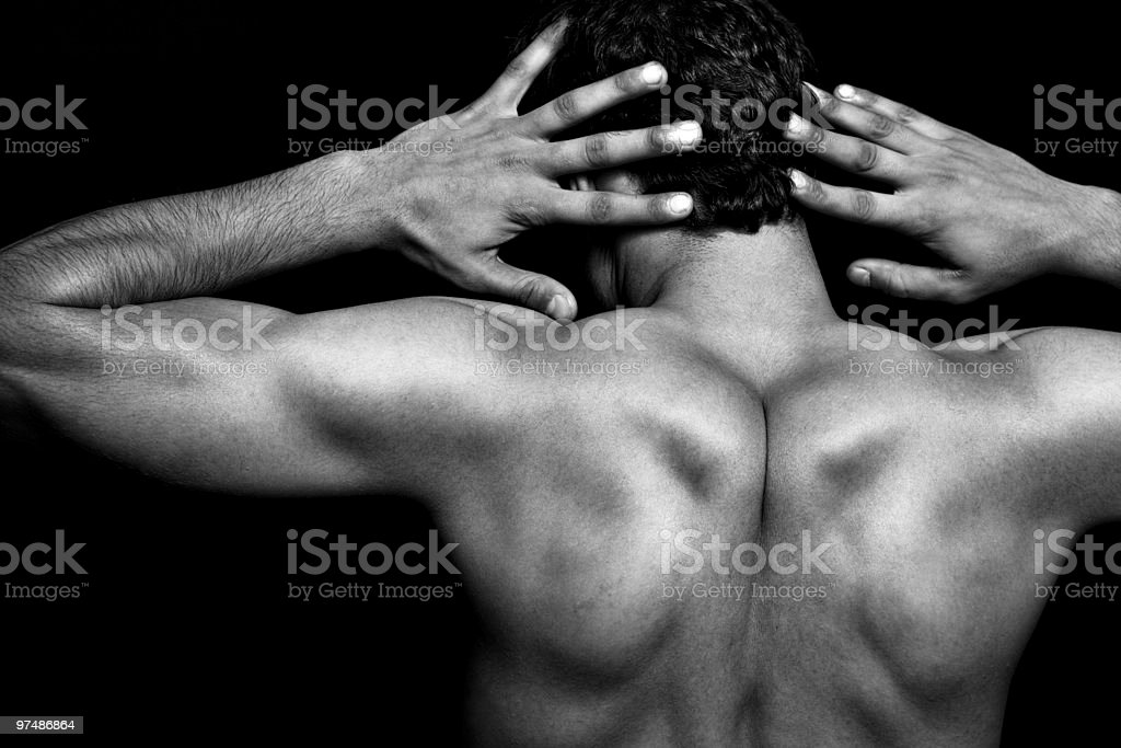 Back of muscular athletic young man royalty-free stock photo