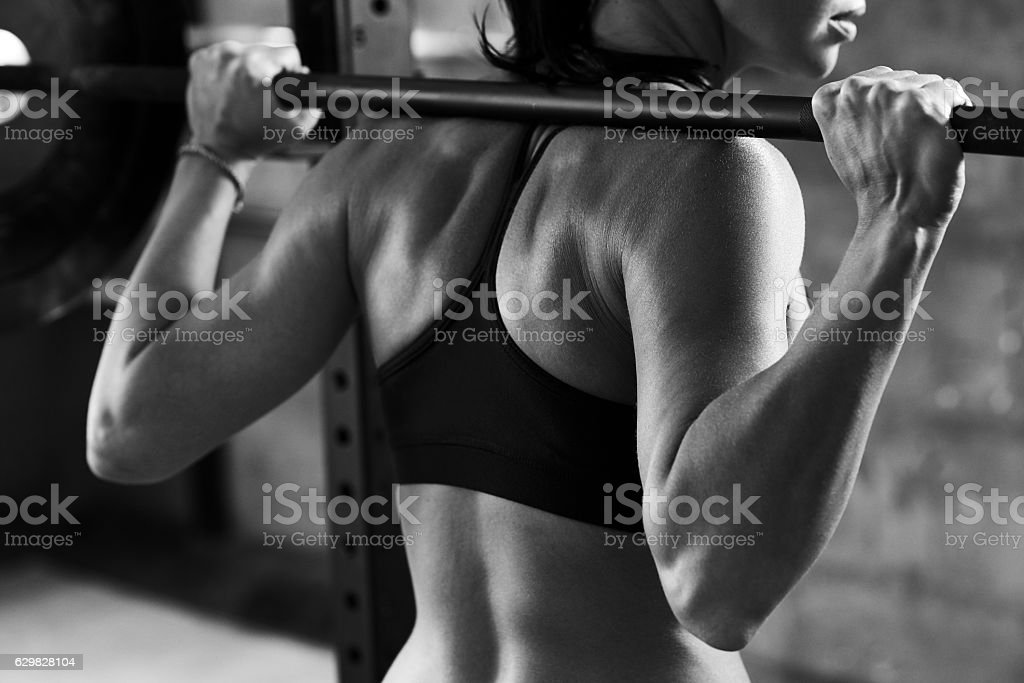 Back of muscular woman stock photo