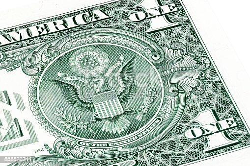 istock Back of one dollar bill. Stacked macro photo 858526344