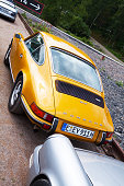 Essen, Germany - June 1, 2014: Back of Porsche 911T, view along two Porsche cars standing on parking space on grounds of Zeche Zollverein.