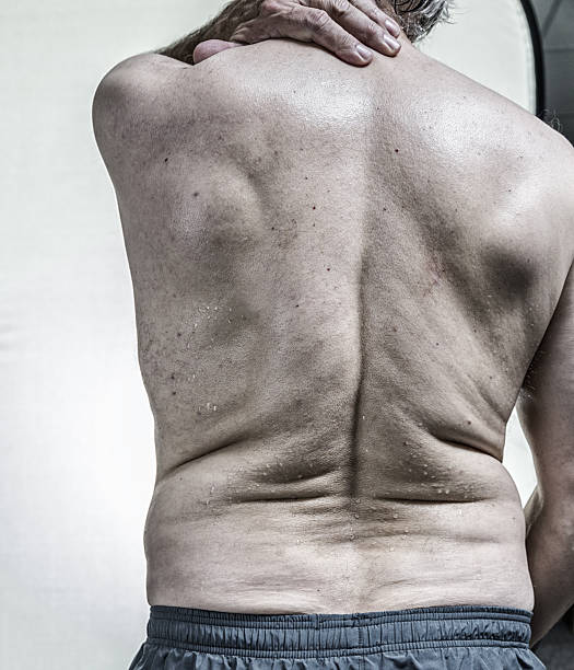 Back of Real Body Senior Man Sweating After Gym Workout stock photo