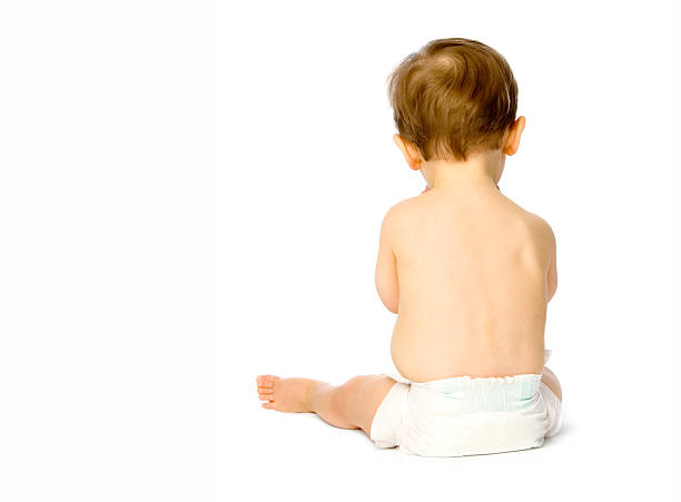 Back of small baby boy in nappy isolated on white stock photo