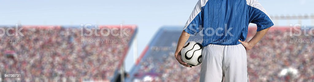 Back of soccer player in front of full stadium royalty-free stock photo