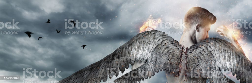 back of strong angel with wings in fire - foto de stock