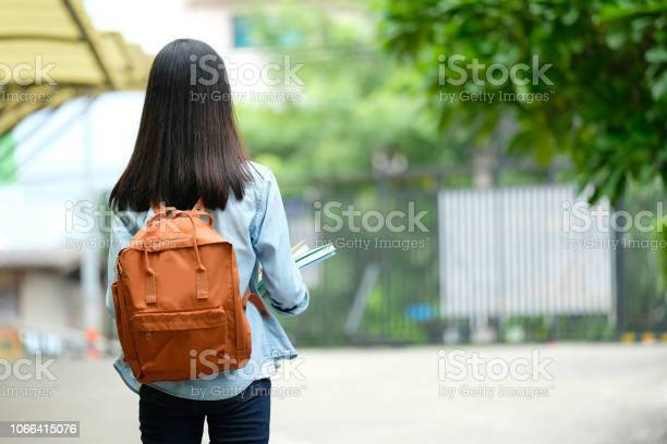 Back of student girl holding books and carry school bag while walking picture id1066415076?b=1&k=6&m=1066415076&s=612x612&h=whcqqgjizzfufzwnxricana7a2lvfvjijavulfg0hd4=