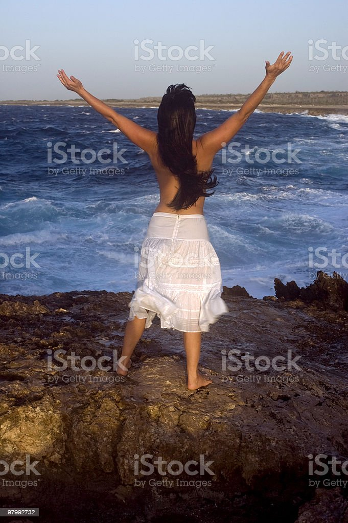 Back of topless woman at the beach royalty-free stock photo