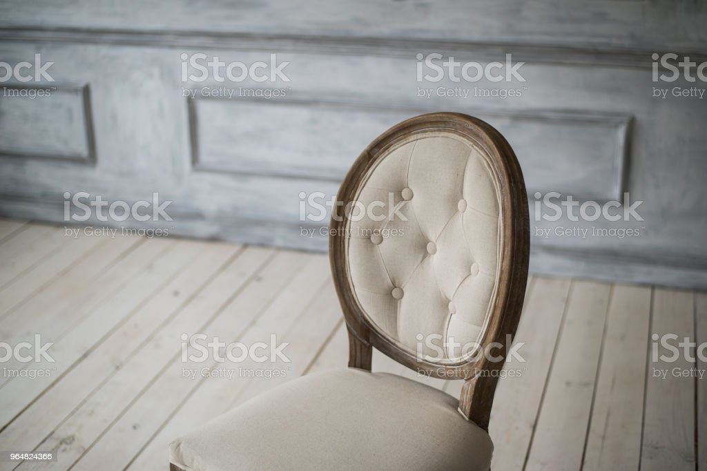 Back of vintage classical style Chair in white room royalty-free stock photo