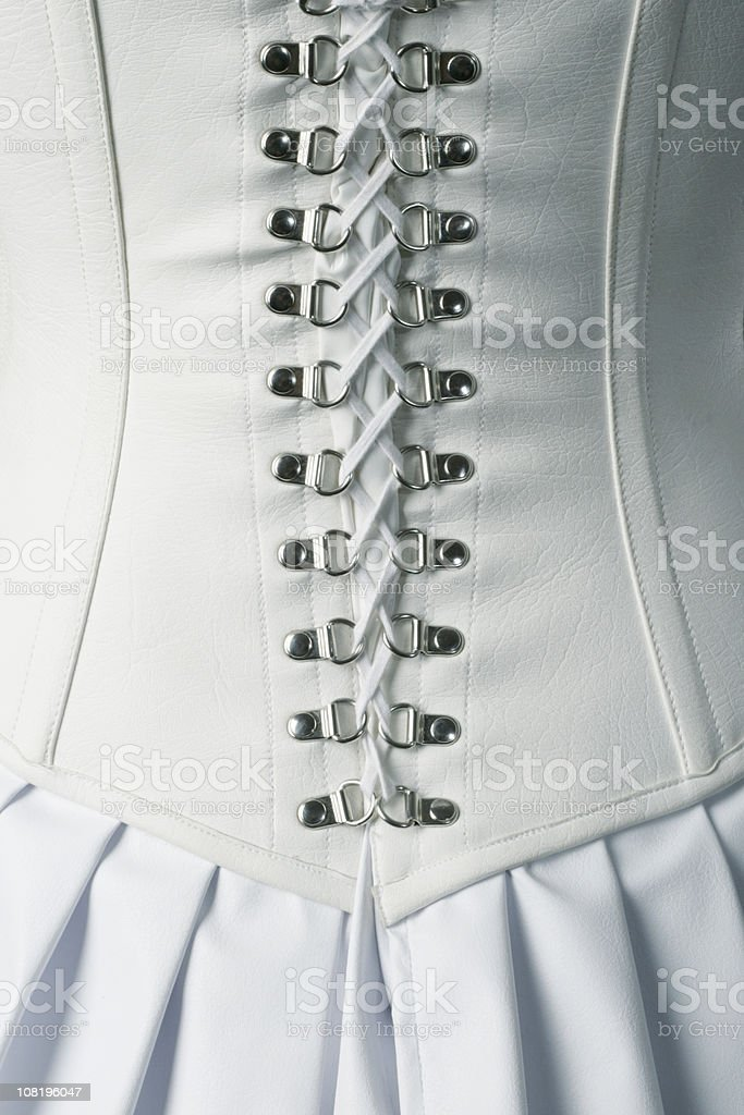 Back of White Leather Corset Ties stock photo