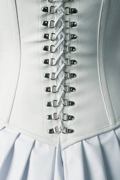 Back of White Leather Corset Ties Back of a white leather corset. corset stock pictures, royalty-free photos & images