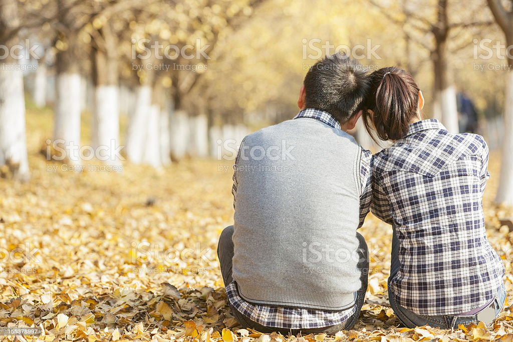 back of young couple in fall royalty-free stock photo