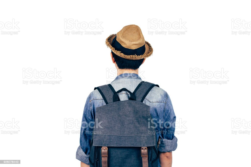 Back of young tourist with hat standing over white background. Backpackers looking the view isolated stock photo