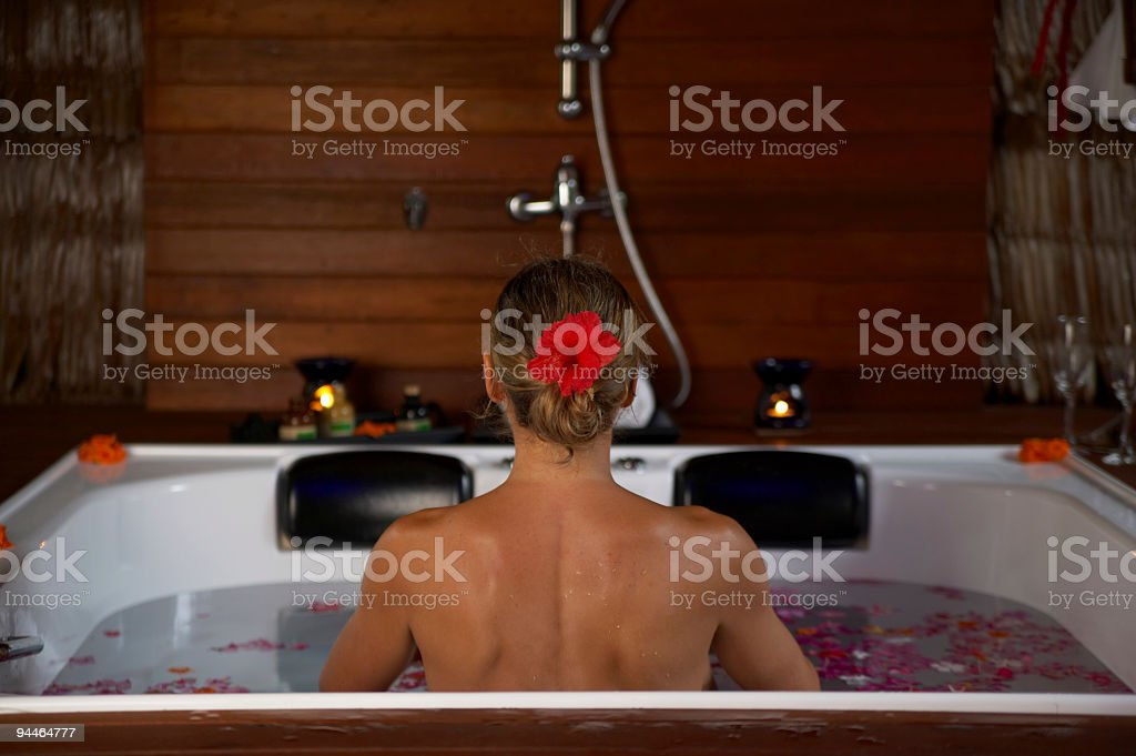 back of young woman in jacuzzi royalty-free stock photo
