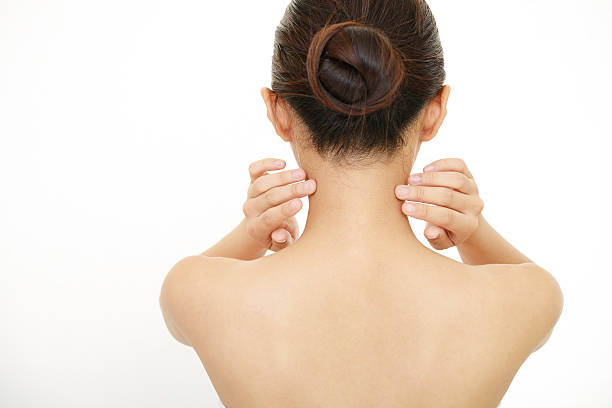 Back of young woman The woman who is doing skin care. human neck stock pictures, royalty-free photos & images