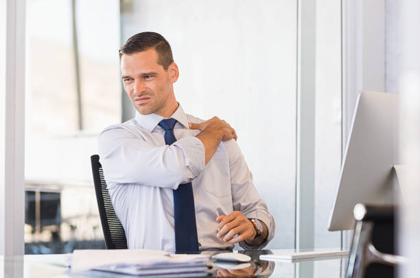 Back pain at work stock photo
