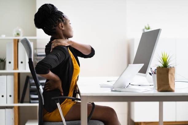 Back Pain Bad Posture Woman Sitting stock photo