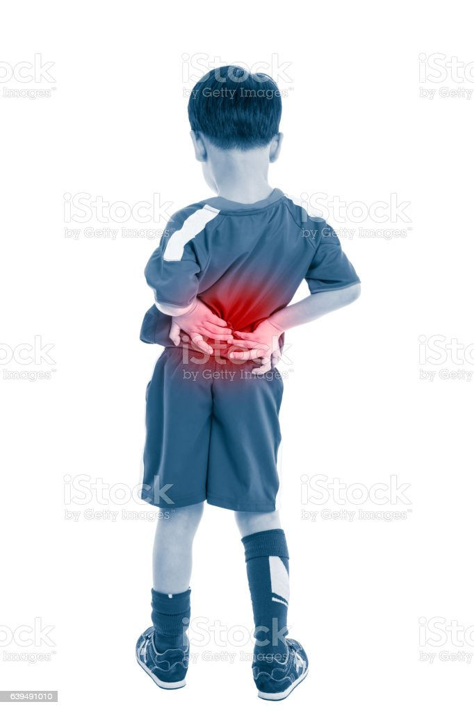 Back pain. Child rubbing the muscles of his lower back. - foto de acervo