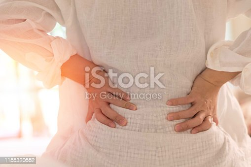 istock Back pain in woman concept. Female patient hurt from lower backache from bowel and bladder problems, palvic inflammatory disease (PID) or motherhood pregnancy. 1155320552
