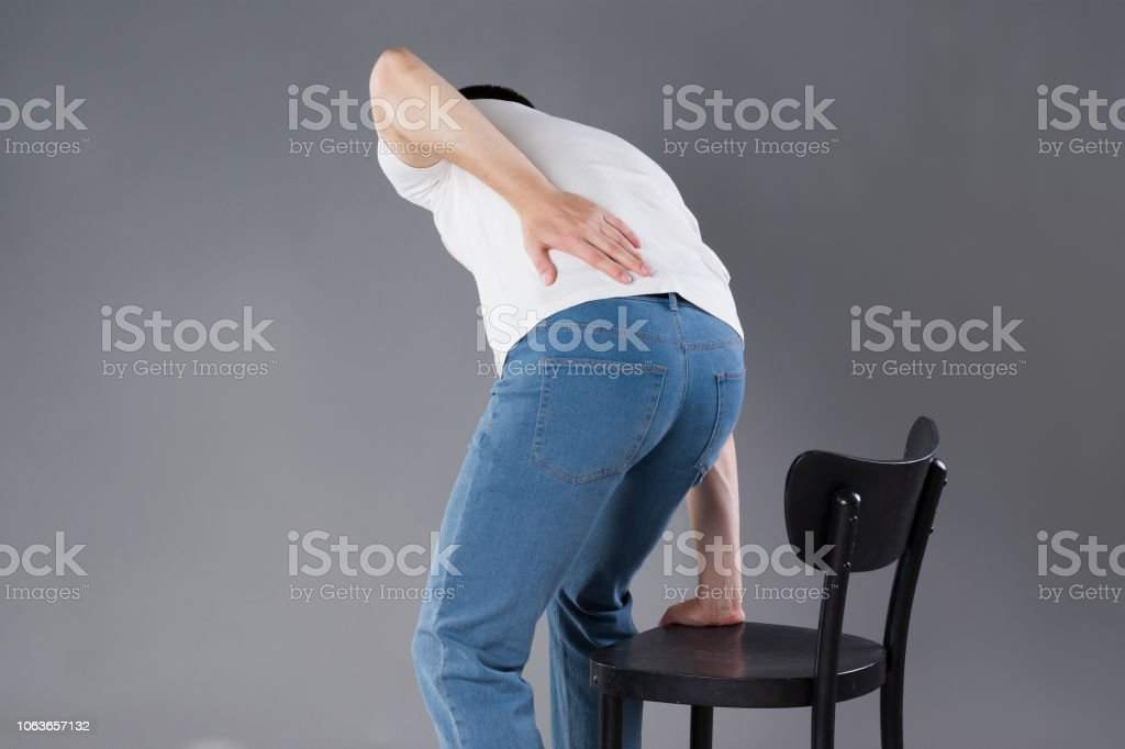 Back pain, kidney inflammation, man suffering from backache, studio...