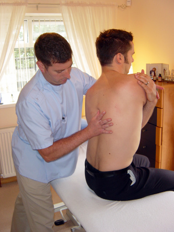 Back Pain Treatment Stock Photo - Download Image Now