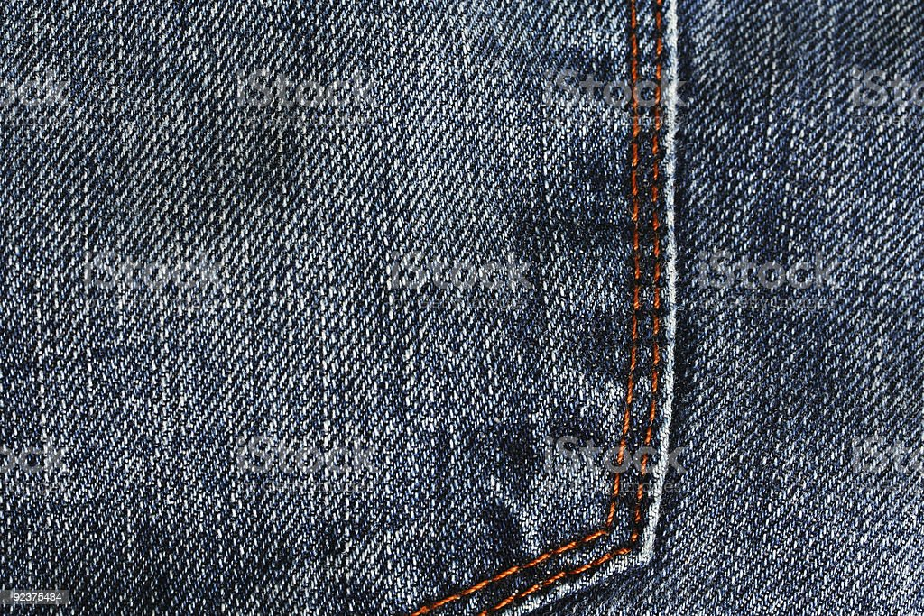 back pocket of denim jeans with orange seam royalty-free stock photo