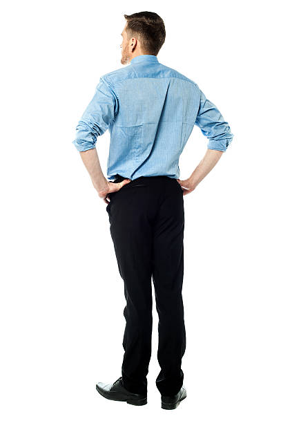 Back pose of a casual businessman stock photo