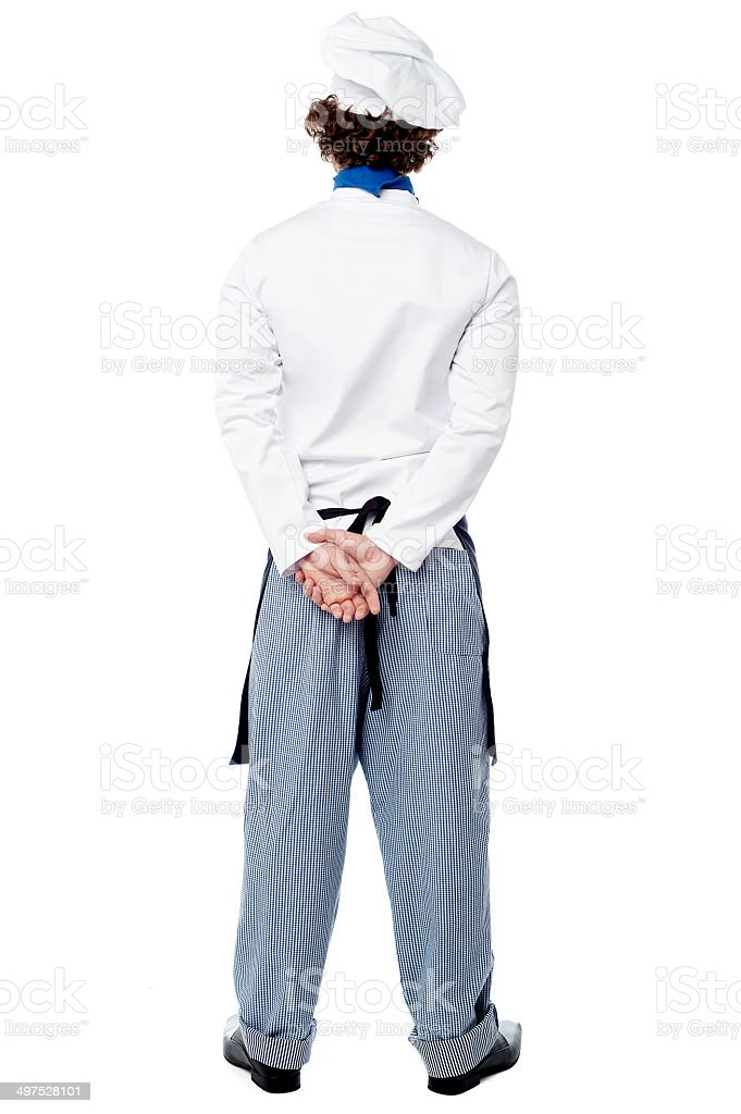 Back pose of a male chef in uniform stock photo