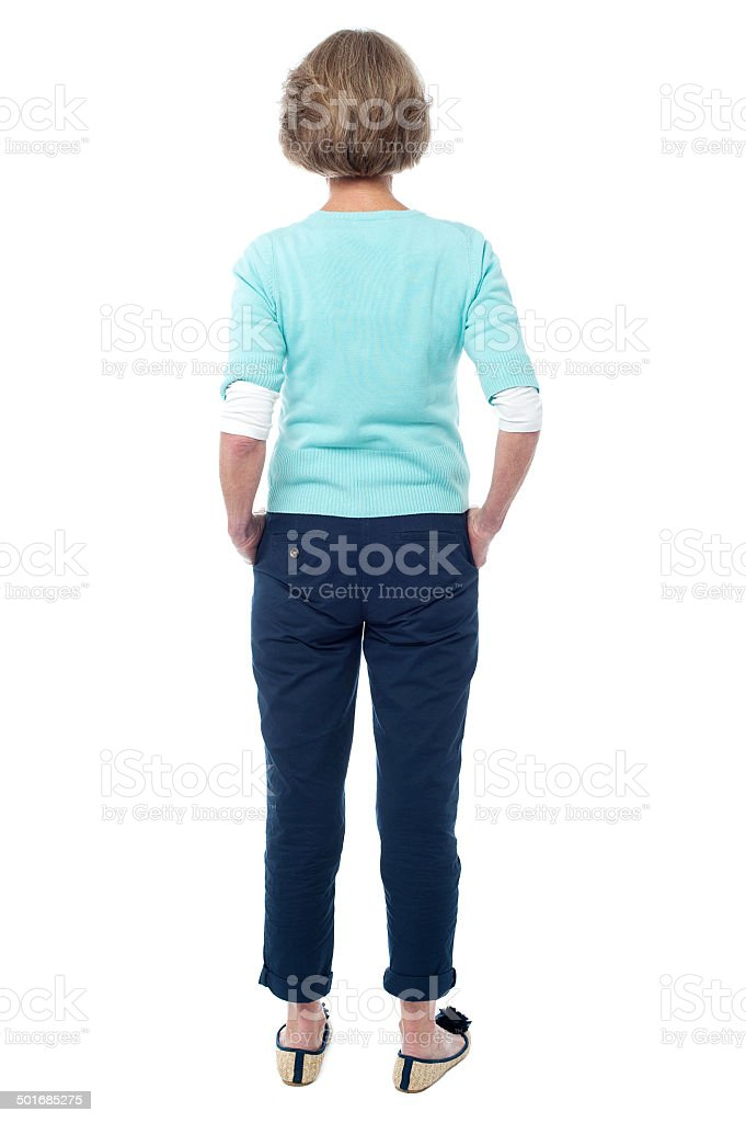 Back pose of an old lady facing the wall royalty-free stock photo