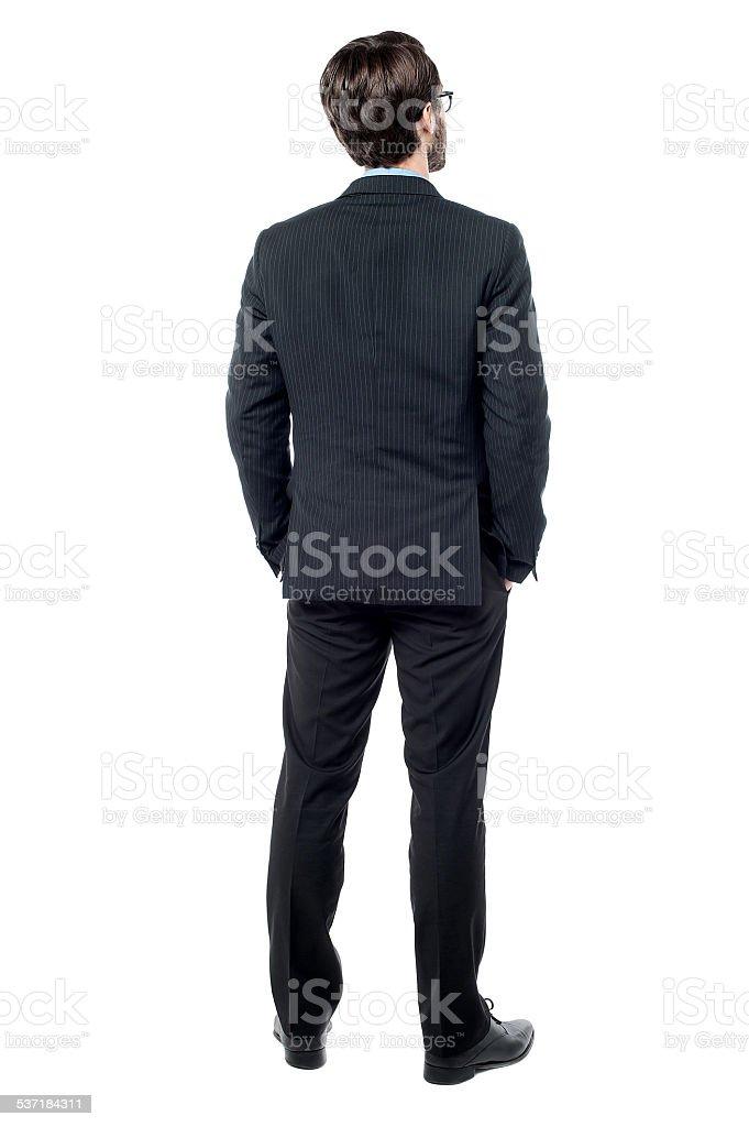 Back pose of male entrepreneur stock photo