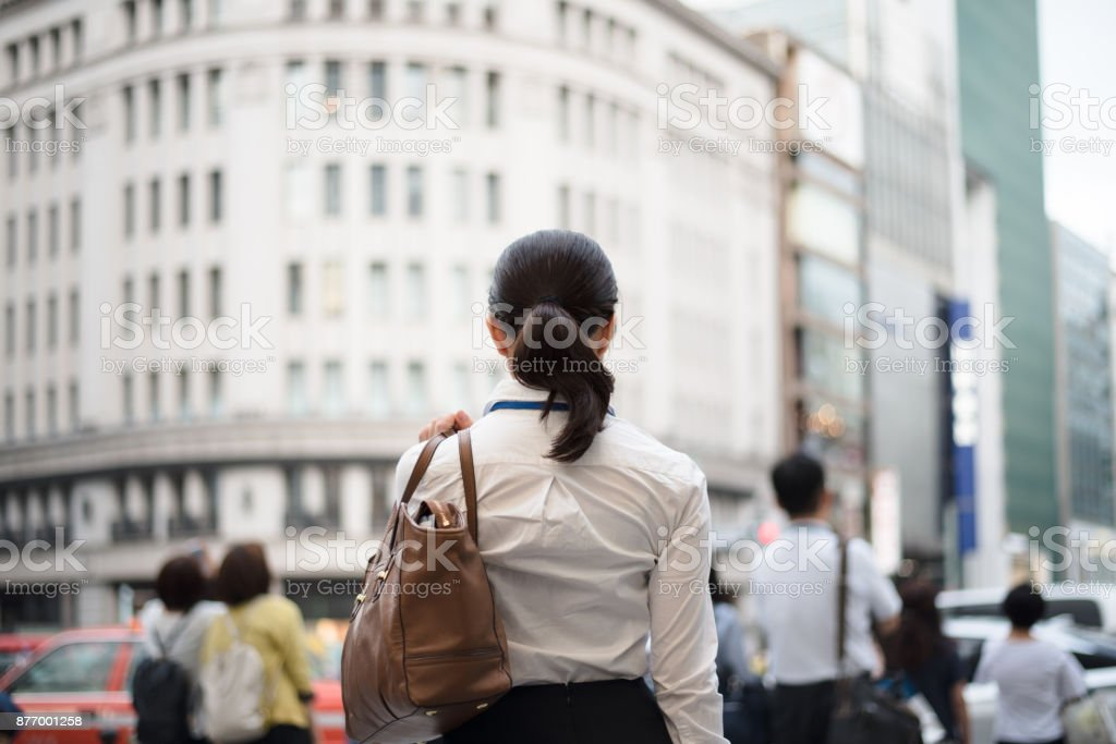 back shot of walking businesswoman in Ginza stock photo