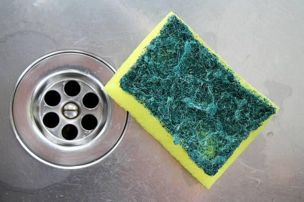 back side of a sponge after cleaning the sink stock photo