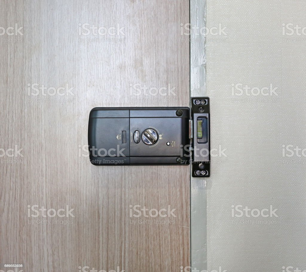 Back side of an electronic door lock room. stock photo