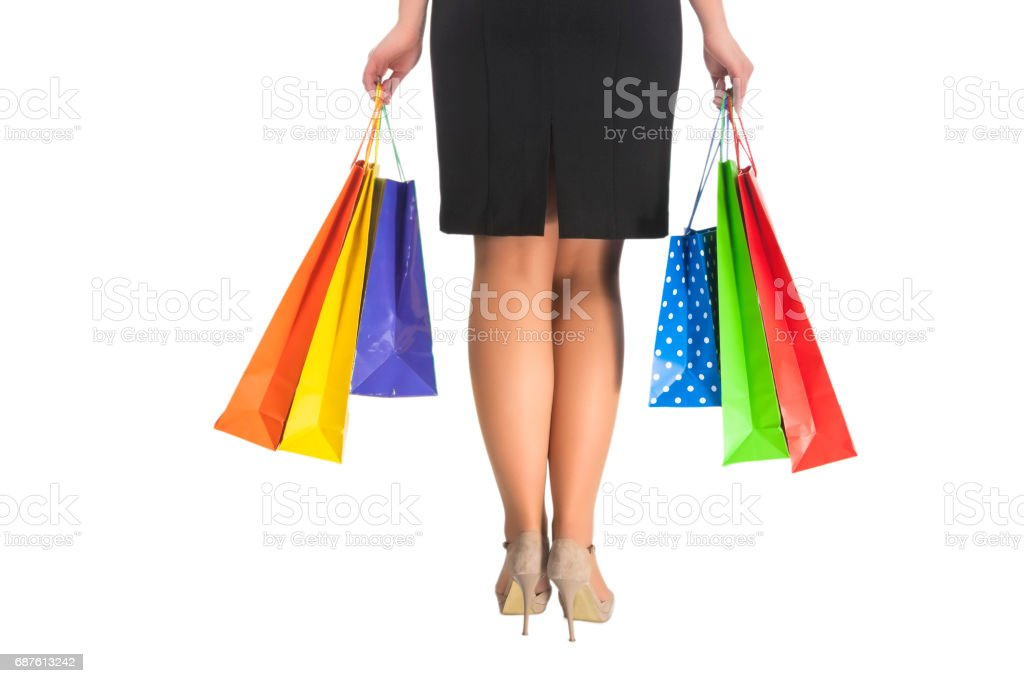 Back Side of Caucasian Woman Holding Shopping Bags. stock photo