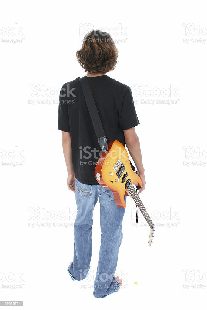 Back Side Of Teen Boy With Electric Guitar Over White stock photo